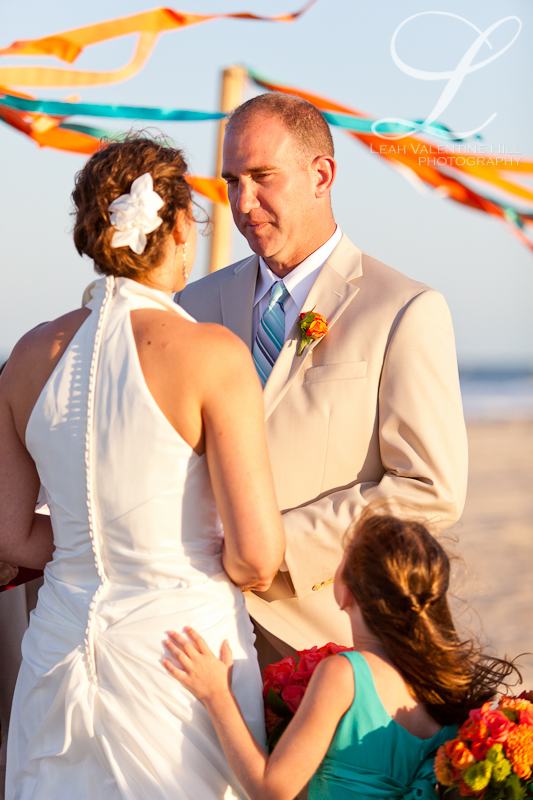 groom tearing up at the ceremony on the beach in nags head, nc