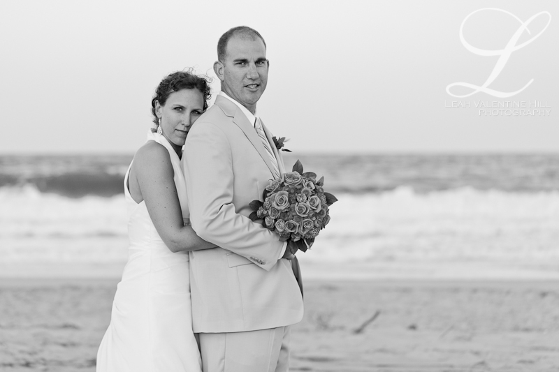 black and white portrait of bride and groom on the beach in nags head, nc