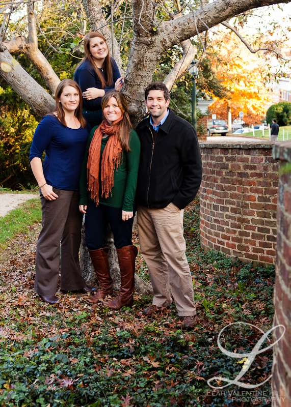 portrait of siblings by the serpentine wall on the UVA campus in charlottesville, va