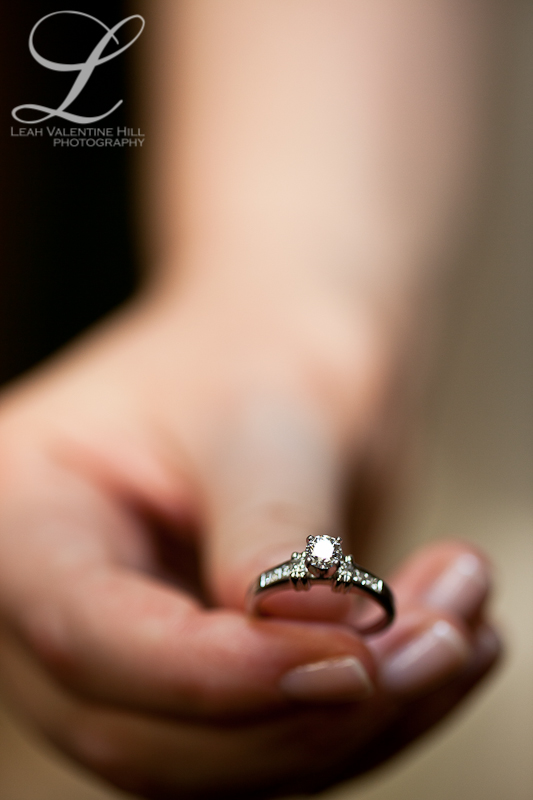 macro photo of bride holding her wedding ring