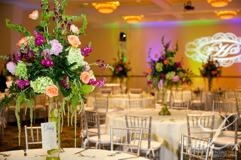 purple orange and green wedding reception flowers with citrus vase filler at Kingsmill Resort in Williamsburg, va