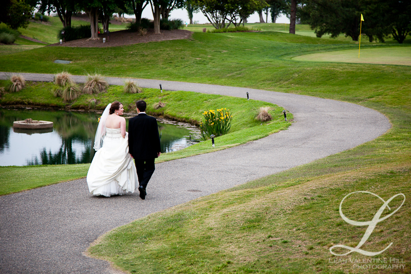 bride and groom walking on path on the golf course at Kingsmill Resort in Williamsburg, va