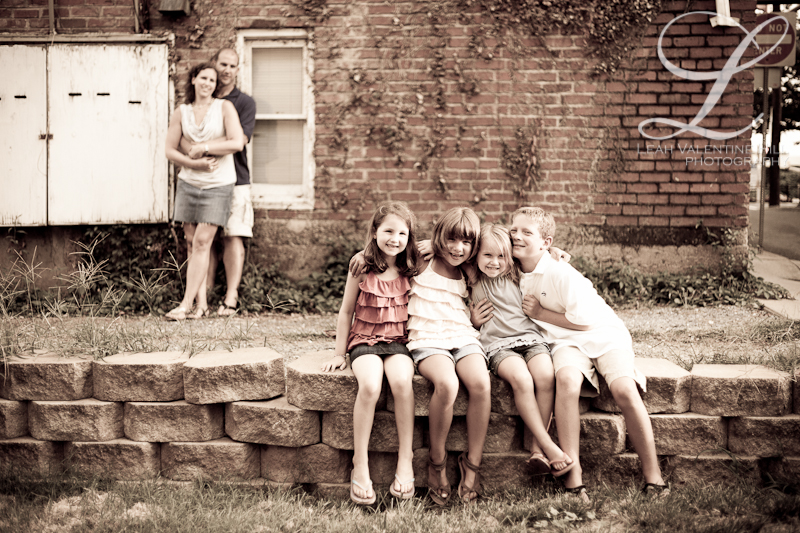 portrait with children sitting in the foreground and parents in the background in charlottesville, va