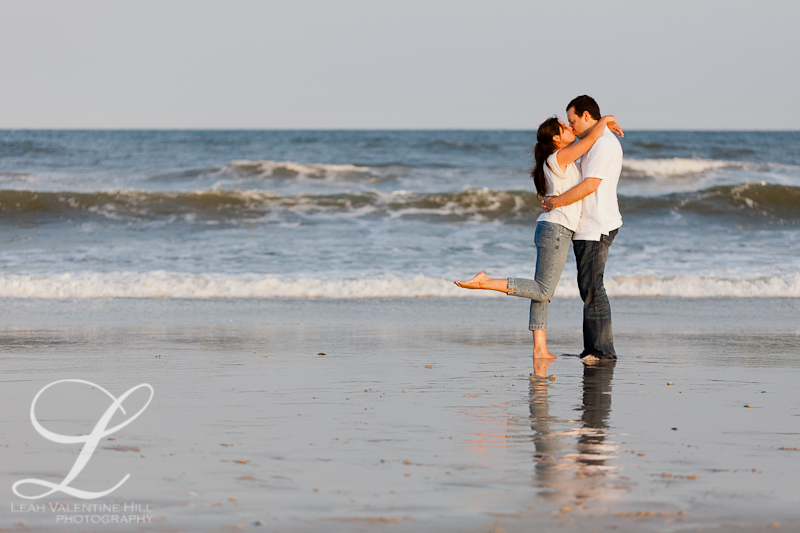 kissing in the waves engagement portrait with reflection on long beach island, nj
