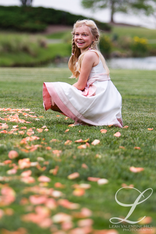 flower girl playing with the rose petals at Kingsmill Resort in Williamsburg, va