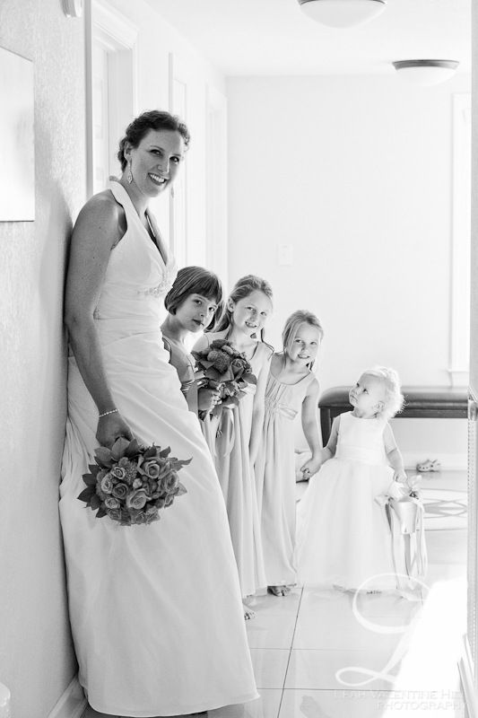 black and white portrait of bride with her flower girls in nags head nc