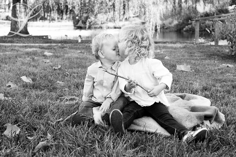 black and white of young siblings on the lawn at the boar