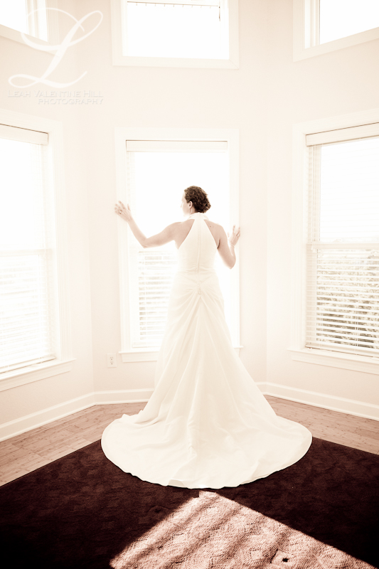 portrait of bride looking out the window in nags head nc