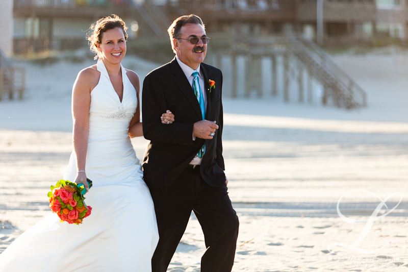 father of the bride walking the bride down the isle on the beach in nags head nc