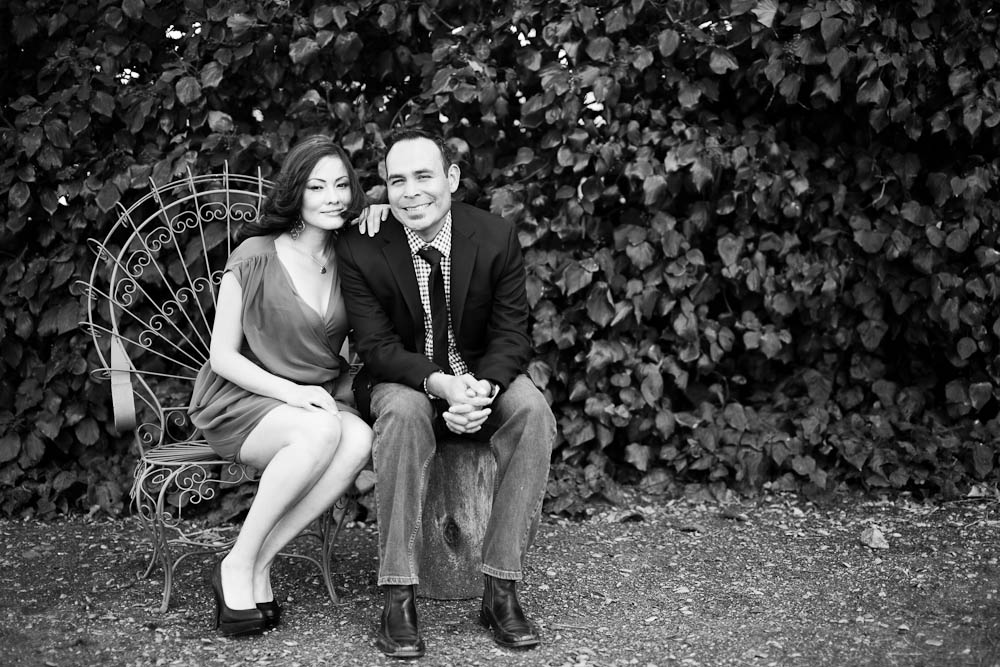 black and white engagement portrait by an ivy wall at Clairmont Lavender Farms in Solvang, CA