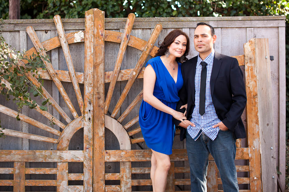engagement portrait by a wooden fence at Clairmont Lavender Farms in Solvang, CA