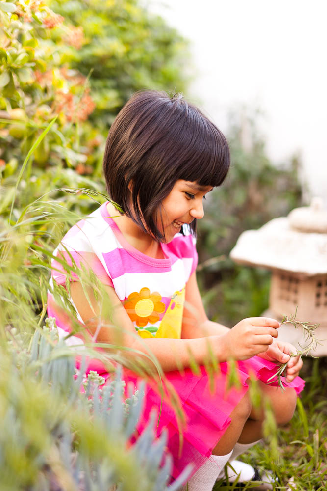 photojournalistic portrait of a young girl in a garden in santa ana, ca