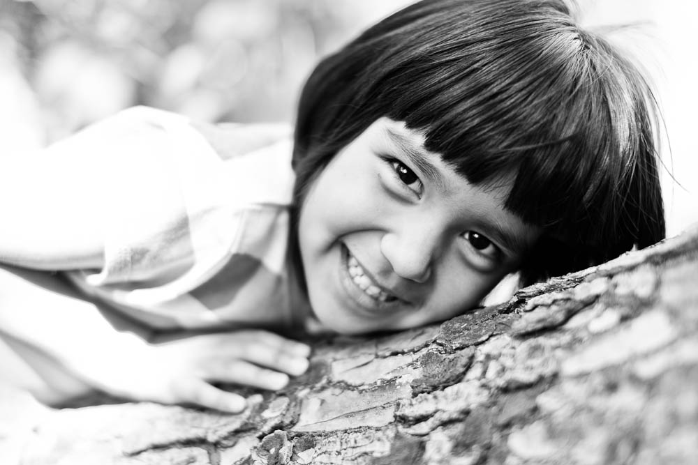 black and white portrait of a girl in a tree in santa ana, ca