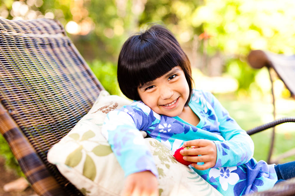 portrait of a young hispanic girl on a chaise in santa ana, ca
