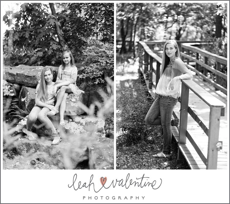 black and white portraits of sisters on a bridge and near a waterfall at wildwood park in west little rock, ar