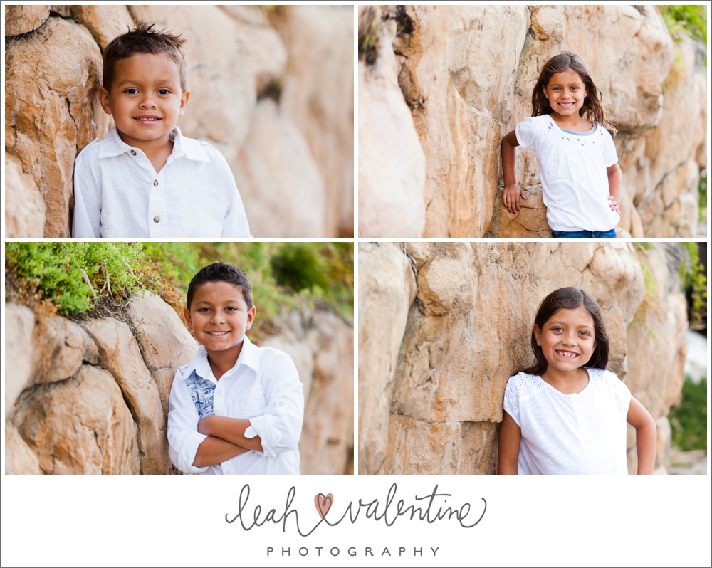 portraits of children against a stone wall on aliso beach at laguna beach, ca