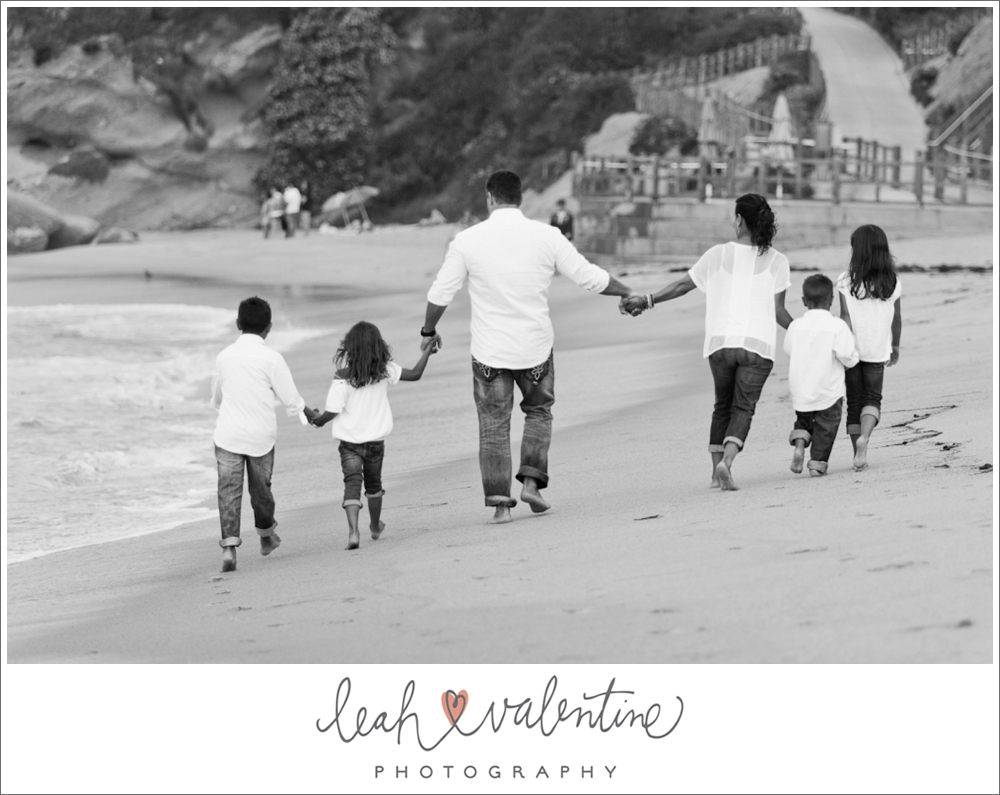 portrait of family walking down laguna beach