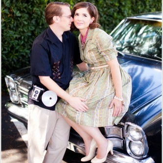 vintage styled engagement portraits with a classic car and vintage brownie camera. Vintage jewelry from Coast 2 Coast Collections in Santa Barbara, CA