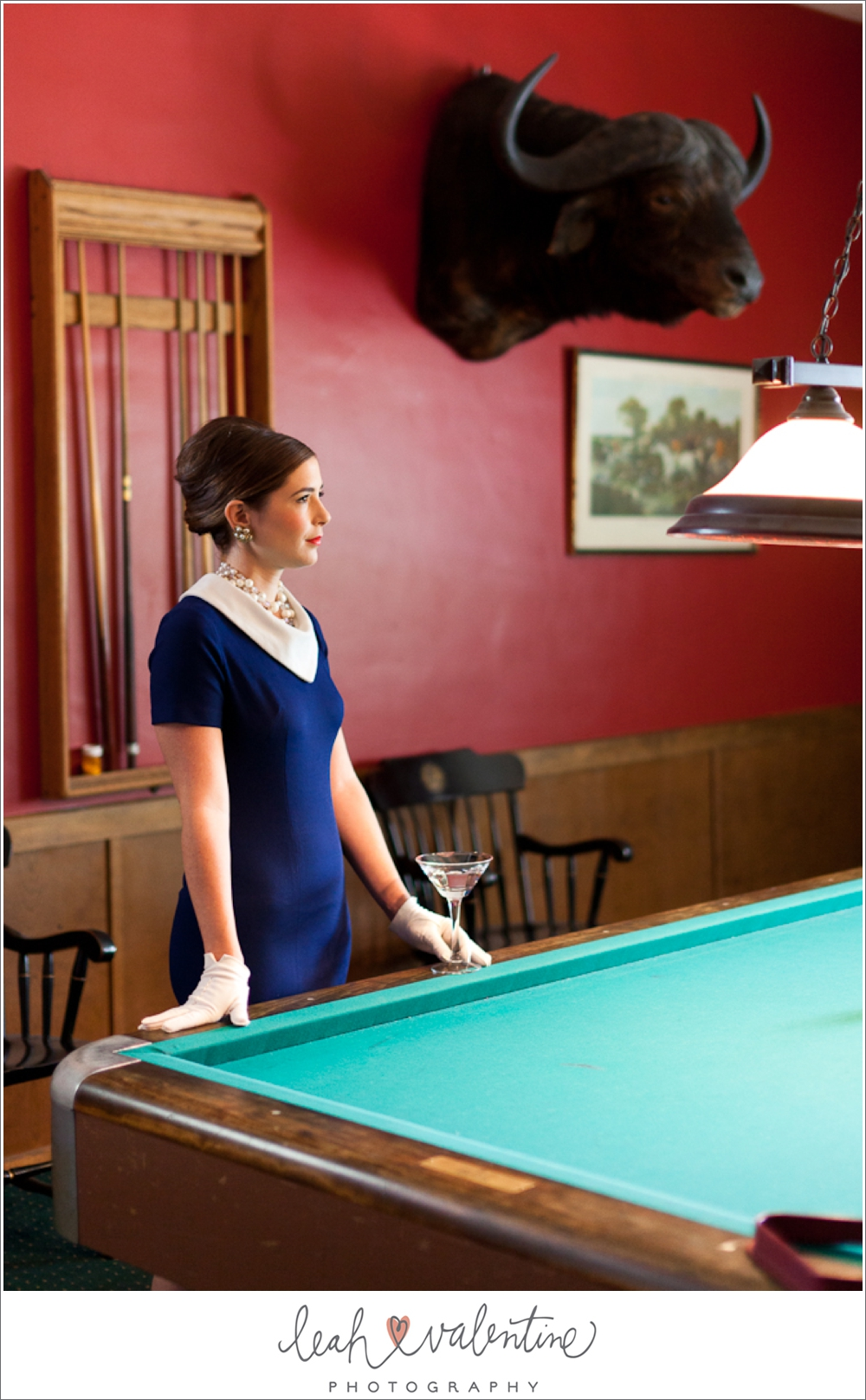 vintage styled engagement portraits, high fashion 1960s blue dress, jewelry by coast 2 coast collections in santa barbara, ca, in a billards room