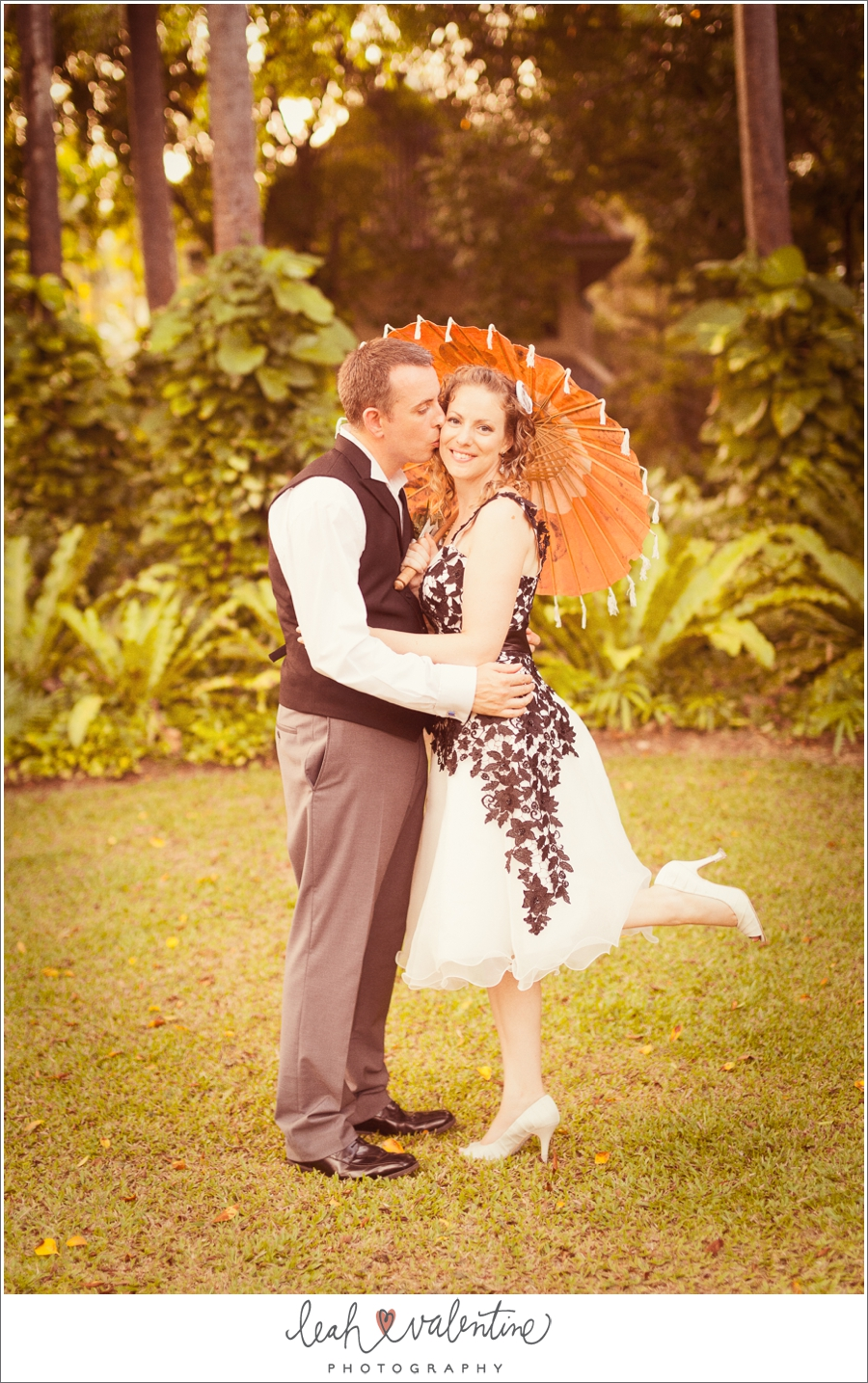 black and white wedding attire with a classic Thai umbrella at a Phuket, Thailand wedding