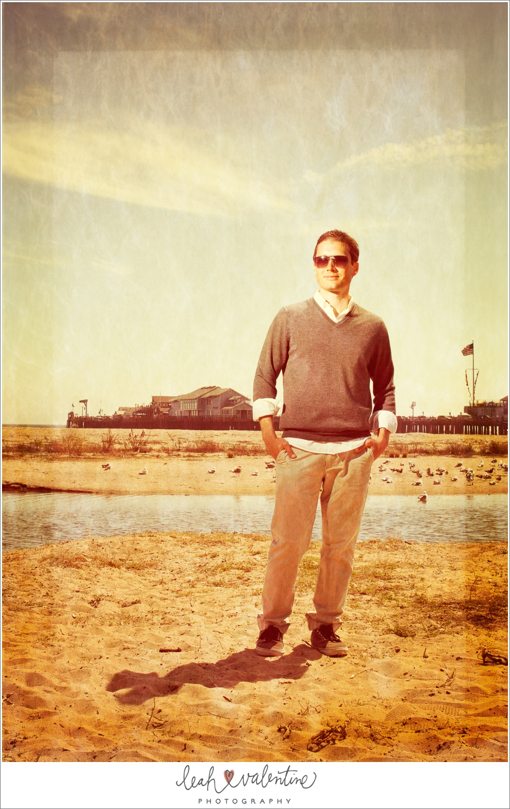 male portrait on the beach in santa barbara with sterns warf in the background