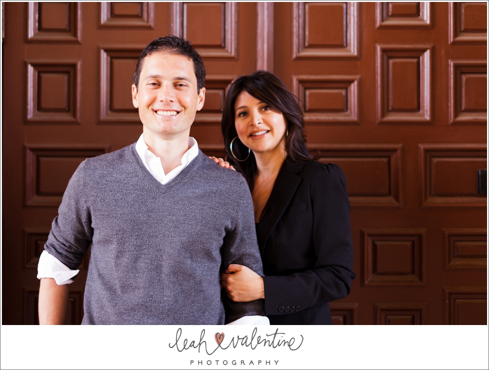 color couples portrait in front of wooden door at santa barbara courthouse